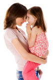 Family Secrets. Mother with daughter sharing secrets isolated Royalty Free Stock Photography