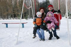 Family on seesaw royalty free stock photography