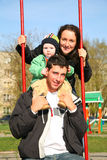 Family on seesaw. On walk royalty free stock photography