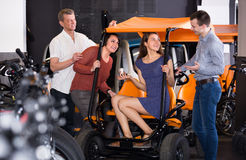 Family selecting grand tour electric at rental Stock Image
