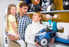 Family selecting vacuum cleaner Stock Photos