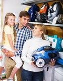 Family selecting vacuum cleaner Stock Photo