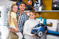 Family selecting vacuum cleaner Royalty Free Stock Images