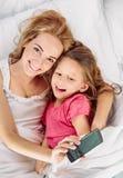 Family selfie in bed Stock Photo