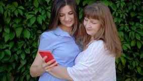 Family selfie modern technology entertainment. Family selfie. Modern technology entertainment. Mother daughter taking picture on smartphone stock footage