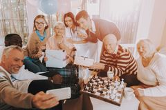 Selfie in Nursing Home. Old Woman Very Surprised. Family Selfie in Nursing Home. Old Woman Very Surprised. Old People Play Chess. Smiling People. Very Happy stock photo