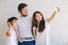 Family selfie in the Studio, with the background. The joy of being together Royalty Free Stock Photo