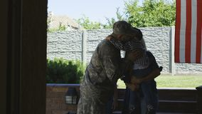 Family sending soldier off to army. Woman with children saying farewell to man before leaving family and home and going to serve in army stock footage