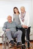 Family with senior citizen couple. Happy family with senior citizen couple and granddaughter at home stock photography