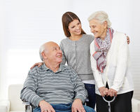 Family with senior couple at home stock images