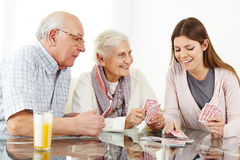 Family with senior couple playing stock photo