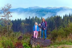 Family on september Carpathian mountain hill Royalty Free Stock Images
