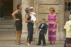 Family setting with little Rickie in a Tuxedo preparing to enter event in Old Havana, Cuba Stock Photography