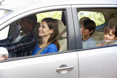 Family Setting Off On Car Journey Stock Images