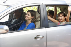 Family Setting Off On Car Journey Stock Photos