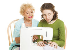 Family Sewing Lesson stock image