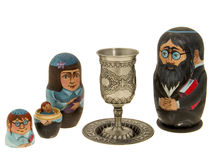 Family. Shabbat. Dolls - the Jewish family with children and a silver cup for wine Royalty Free Stock Image