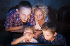 Family shocked for TV Royalty Free Stock Photos