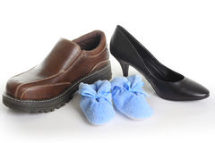Family shoes. Parents shoes with blue booties. Also available with pink booties. Birth announcement concept Royalty Free Stock Photos