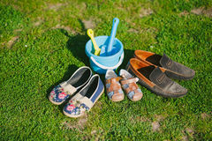 Family shoes. Parent and child shoes. Three pairs of shoes in father big, mother medium and small kid size Stock Photos