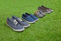 Family Shoes Standing On Green Summer Grass Royalty Free Stock Photography