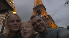 Family shooting selfie by Eiffel Tower, home video style stock video