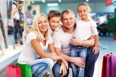 Family of shoppers Stock Images