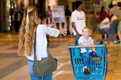 Family shopping. Mother and child having fun on a shopping spree Stock Image