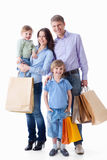 Family with shopping. Bags on a white background stock images