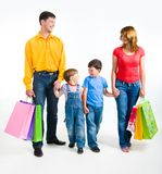 Family shopping. Photo of friendly family walking with shopping bags over white background stock images