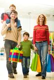 Family shopping. Modern family going shopping in trade center before Christmas time royalty free stock image