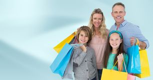 Family with shopping bags against blurry blue abstract background. Digital composite of Family with shopping bags against blurry blue abstract background stock photo