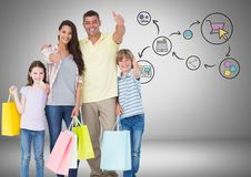 Family with shopping bags and online shopping graphic drawings. Digital composite of Family with shopping bags and online shopping graphic drawings Royalty Free Stock Photos
