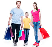 Family with shopping bags standing at studio. royalty free stock photos