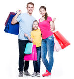 Family with shopping bags standing at studio. Stock Image