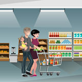 Family shopping with cart. Family in a supermarket with a food cart Stock Image