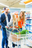 Family with shopping cart in supermarket Royalty Free Stock Image