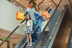 Family shopping for clothes and looking happy. In shopping mall royalty free stock photos