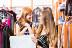 Family shopping fashion in store Stock Photos