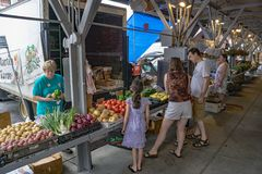 Family Shopping for Fresh Vegetables at the Roanoke City Market royalty free stock photo
