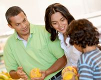 Family shopping for groceries Stock Images