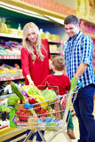 Family shopping in grocery market Stock Photo