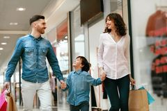 Family Shopping. Happy People In Mall. Family Shopping. Happy People With Child Carrying Bags, Walking In Modern Mall. High Resolution stock images