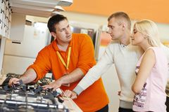 Family shopping at home appliance supermarket Stock Image