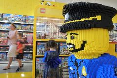 Family shopping in a lego shop. During the Christmas season almost 28 LEGO sets are sold each second royalty free stock photography