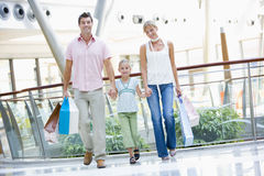Family shopping in mall. Carrying bags royalty free stock images