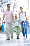 Family shopping in mall. Carrying bags Royalty Free Stock Photo