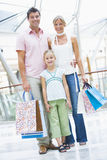 Family shopping in mall. Carrying bags Stock Image