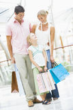Family shopping in mall Stock Images