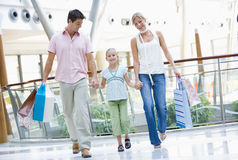 Family shopping in mall. Carrying bags stock photo